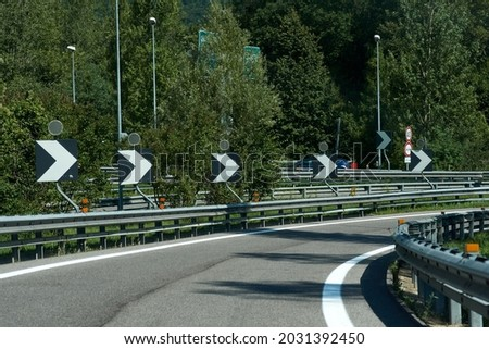 Winding road, Beautiful curved road, Asphalt road curve. High quality photo Royalty-Free Stock Photo #2031392450