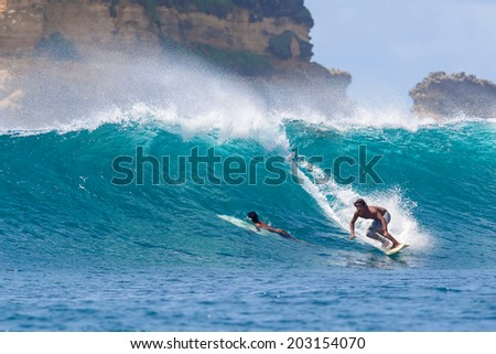 Surfing a Wave. Lombok Island. Indonesia. #203154070