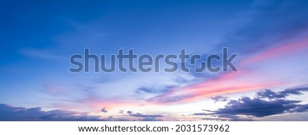 The morning sky looked like a bright golden sky. The sunrise is decorated with clouds in various shapes. Looks beautiful. Royalty-Free Stock Photo #2031573962