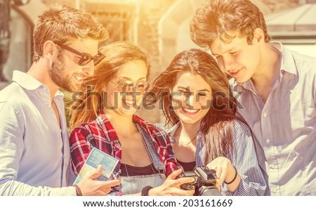 friends watching photos in the reflex #203161669