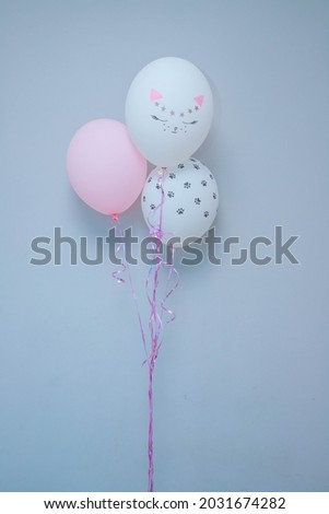 balloons with the image of a cat's face
