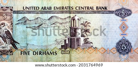 Reverse side of 5 five Emirates Dirhams banknote of the United Arab Emirates, currency of the UAE issued 2000 with Imam Salem Al Mutawa Mosque or Al Jamaa mosque in Sharjah, Khor Fakkan and a falcon Royalty-Free Stock Photo #2031764969
