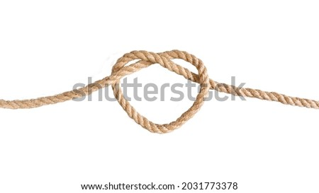 A jute rope tied in the shape of a heart. A symbol of connection, love, a bond. The concept of a strong relationship. A heart-shaped knot. Royalty-Free Stock Photo #2031773378