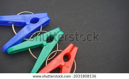 The clothespins are made of plastic with a little additional iron attachment, and there are many color options. Royalty-Free Stock Photo #2031808136