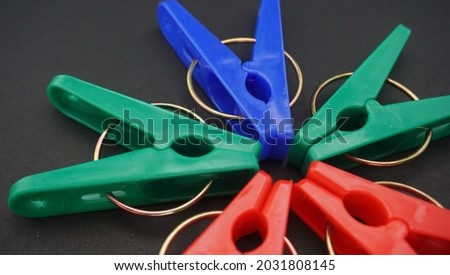 The clothespins are made of plastic with a little additional iron attachment, and there are many color options. Royalty-Free Stock Photo #2031808145