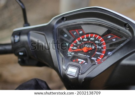 Close-up view of speedometer on motorcycle (Indonesian scooter or Motor Bebek) Royalty-Free Stock Photo #2032138709