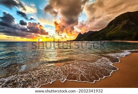 Sunrise on the sea beach. Beautiful sandy beach at dawn. Beautiful sunrise in beach. Sunrise on beach landscape Royalty-Free Stock Photo #2032341932