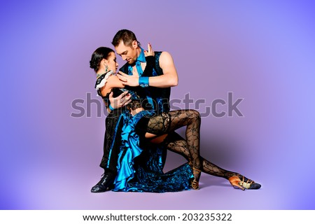 Beautiful professional dancers perform tango dance with passion and expression.  #203235322