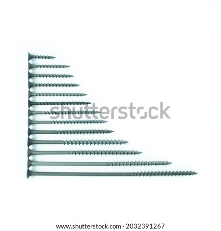 Self-tapping screws, window fasteners, screws, bolts, screws, rods, hardware, anchors, dowels, metal fasteners on a white background. Fasteners for construction. Royalty-Free Stock Photo #2032391267