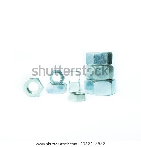 Nuts, washers, screws, bolts, rings, rods, hardware, metal fasteners on a white background. Fasteners for construction. Close-up. Royalty-Free Stock Photo #2032516862
