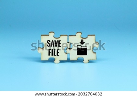 wooden puzzle with save file icon and save file text