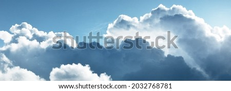 Ornamental clouds. Dramatic sky. Epic storm cloudscape. Soft sunlight. Panoramic image, texture, background, graphic resources, design, copy space. Meteorology, heaven, hope, peace concept Royalty-Free Stock Photo #2032768781