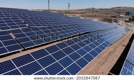 Aerial view of close up solar power panels, in desert. Royalty-Free Stock Photo #2032847087