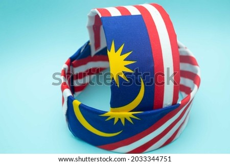 A unique hat with Malaysia flags done by Malaysian boy