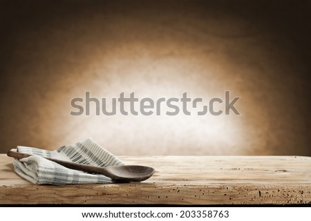 spoon napkin and desk with brown wall of shadow  #203358763