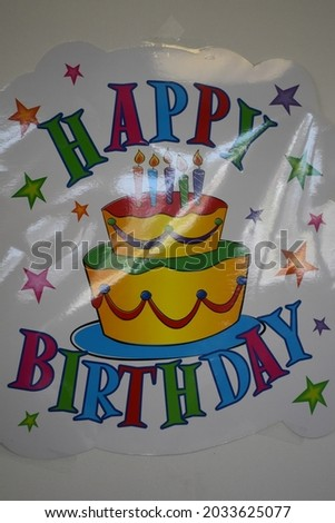 Happy Birthday sign with a cake