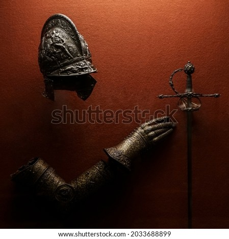 medieval armor made of wrought iron. knight helmet iron medieval age armor, decoration in historical museum.  Royalty-Free Stock Photo #2033688899