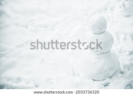 Empty Snowman standing in the snow, copyspace Royalty-Free Stock Photo #2033736320