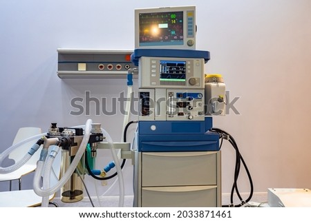 Anesthesia and respiratory apparatus. Anesthesia machine with multiple breathing tubes. Equipment for carrying out inhalation narcosis. Medical equipment. Sale of anesthesia and breathing apparatus Royalty-Free Stock Photo #2033871461