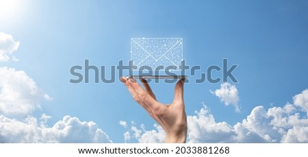 Male hand holding letter icon,email icons .Contact us by newsletter email and protect your personal information from spam mail. Customer service call center contact us.Email marketing and newsletter. Royalty-Free Stock Photo #2033881268