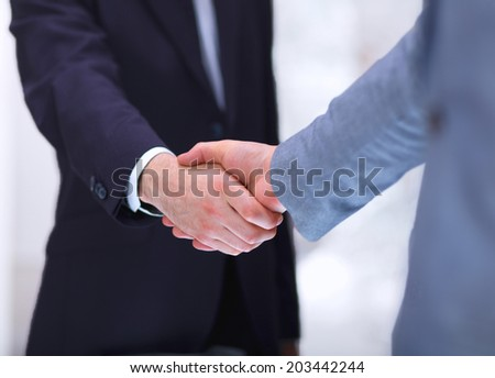 Businessmen shaking hands, isolated on white.  #203442244