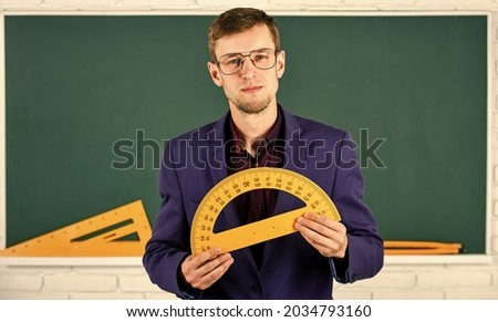 geometry favorite subject. male teacher hold protractor. education and school concept. stem school disciplines. mathematics and people concept. man at blackboard. back to school