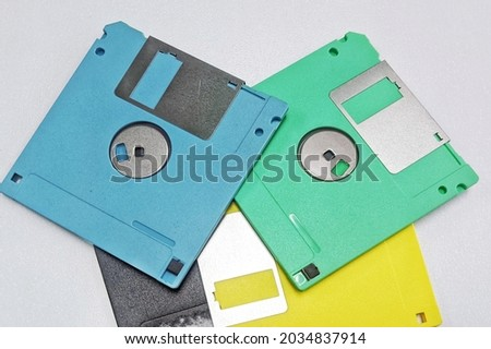 A floppy disk, also known as a floppy, diskette, or simply disk, is a type of disk storage composed of a disk of thin and flexible magnetic storage