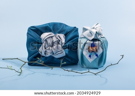 Korean traditional wrapping cloth on the color background. wrapping cloth gift packaging Royalty-Free Stock Photo #2034924929