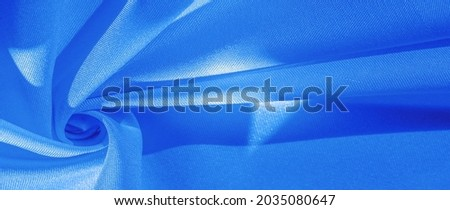 blue silk fabric, smooth satin fabric in sapphire shades. Texture, background, pattern Royalty-Free Stock Photo #2035080647