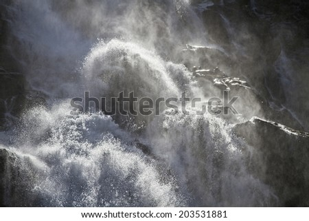 The 320 m high Stigfossen plunges spectacularly beside the Trollstigen Pass road in the depth #203531881