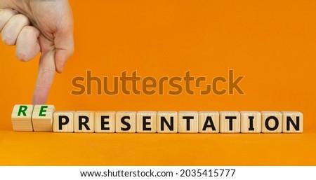 Presentation representation symbol. Businessman turns cubes, changes words presentation to representation. Beautiful orange background, copy space. Business, presentation or representation concept. Royalty-Free Stock Photo #2035415777