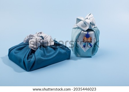 Korean traditional wrapping cloth on the color background. wrapping cloth gift packaging Royalty-Free Stock Photo #2035446023