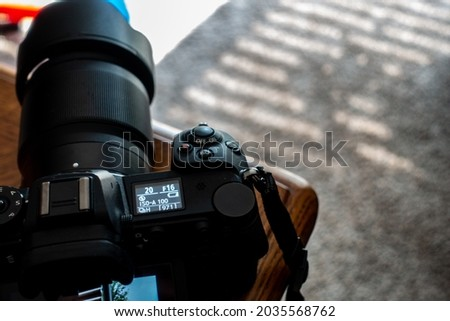 Selective focus on low battery display of a high end camera before shutting down