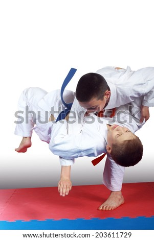 Two athletes in judogi are doing throws #203611729