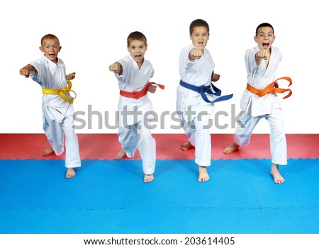 Four sportsman in karategi and with belts are beating blows hands #203614405