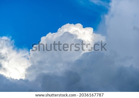Cumulus clouds. Background with white clouds floating above the ground at flight altitude. Picture for weather forecast.