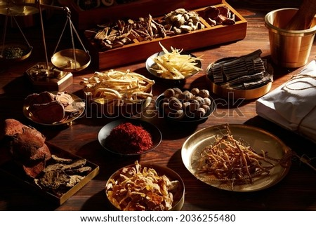 Traditional chinese herbal medicine. Ancient Chinese medicine and herbs on wooden table Royalty-Free Stock Photo #2036255480