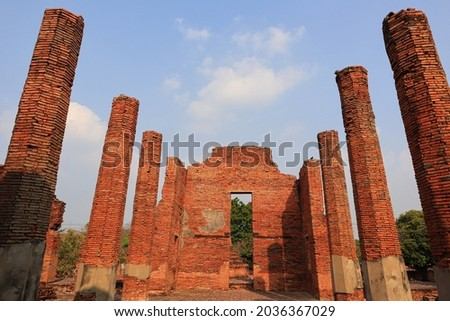 A view of the ancient temple's structure at Wat Phra Si Sanphet that is part of historical park in Ayutthaya, Thailand. In this picture can see the high pillars of the temple.