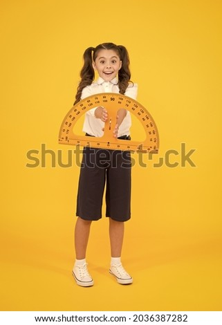 Engineering course. Geometry concept. Schoolgirl holding protractor for lesson. Little child preparing for geometry. Adorable small girl using measuring instrument. Study geometry. Future architect