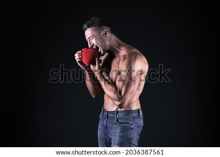 Vitamins for heart. Eat healthy. Romantic muscular guy. Man muscular macho romantic date. Fall in love sportsman. Bodybuilder muscular chest preparing for date outdoors or night out. Health care Royalty-Free Stock Photo #2036387561