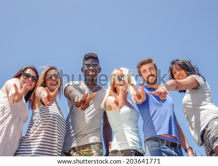 Group of friends showing a v hand sign