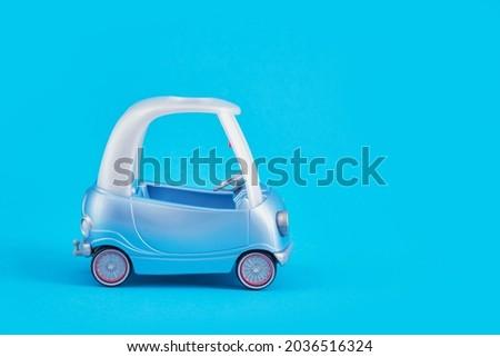 plastic toy car on blue background golf car copy space