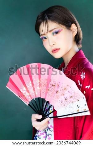 Young asian woman wearing kimono. Japanese girl. Geisha girl. Royalty-Free Stock Photo #2036744069