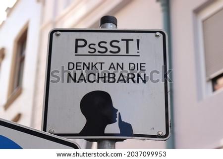 """Warning sign against noise """"Psst! Denkt an die Nachbarn"""" means """"Psst! thinks of the neighbors"""""""