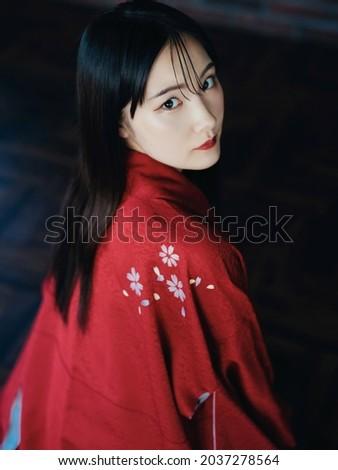 Young asian woman wearing kimono. Japanese girl. Royalty-Free Stock Photo #2037278564
