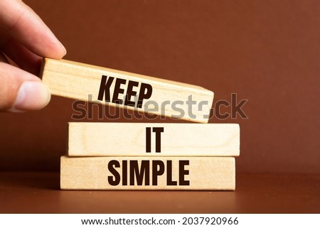 Keep it simple - word from wooden blocks with letters, to make something easy, keep it simple concept Royalty-Free Stock Photo #2037920966