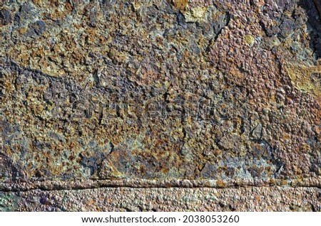 A close up of a dirty grunge old rusty wall with facet and rough snags Royalty-Free Stock Photo #2038053260