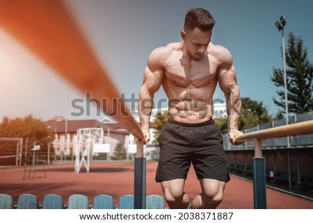 attractive muscular athlete man or bodybuilder pull up and exercising outdoor Royalty-Free Stock Photo #2038371887
