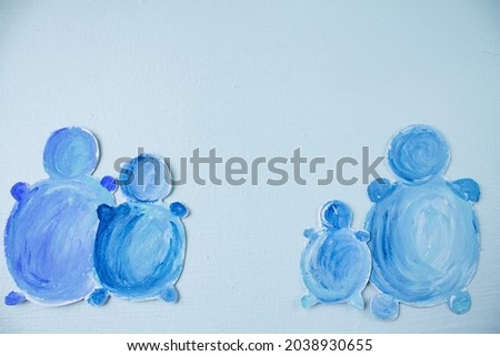 painted snowmen. snowmen are blue in color. blue background. winter greeting card Royalty-Free Stock Photo #2038930655