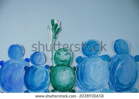 painted snowmen. snowmen are blue in color. blue background. winter greeting card Royalty-Free Stock Photo #2038930658